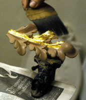 Gilding an ornamental detail